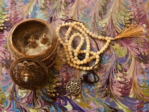 writer's alter with incense, male beads, pagan talisman