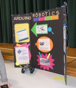 Science fair robotics display on posterboard.
